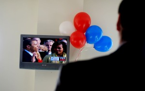 A man watches the swearing in during an office party. Many businesses and organizations held watch parties for the Inaugural swearing in and parade.